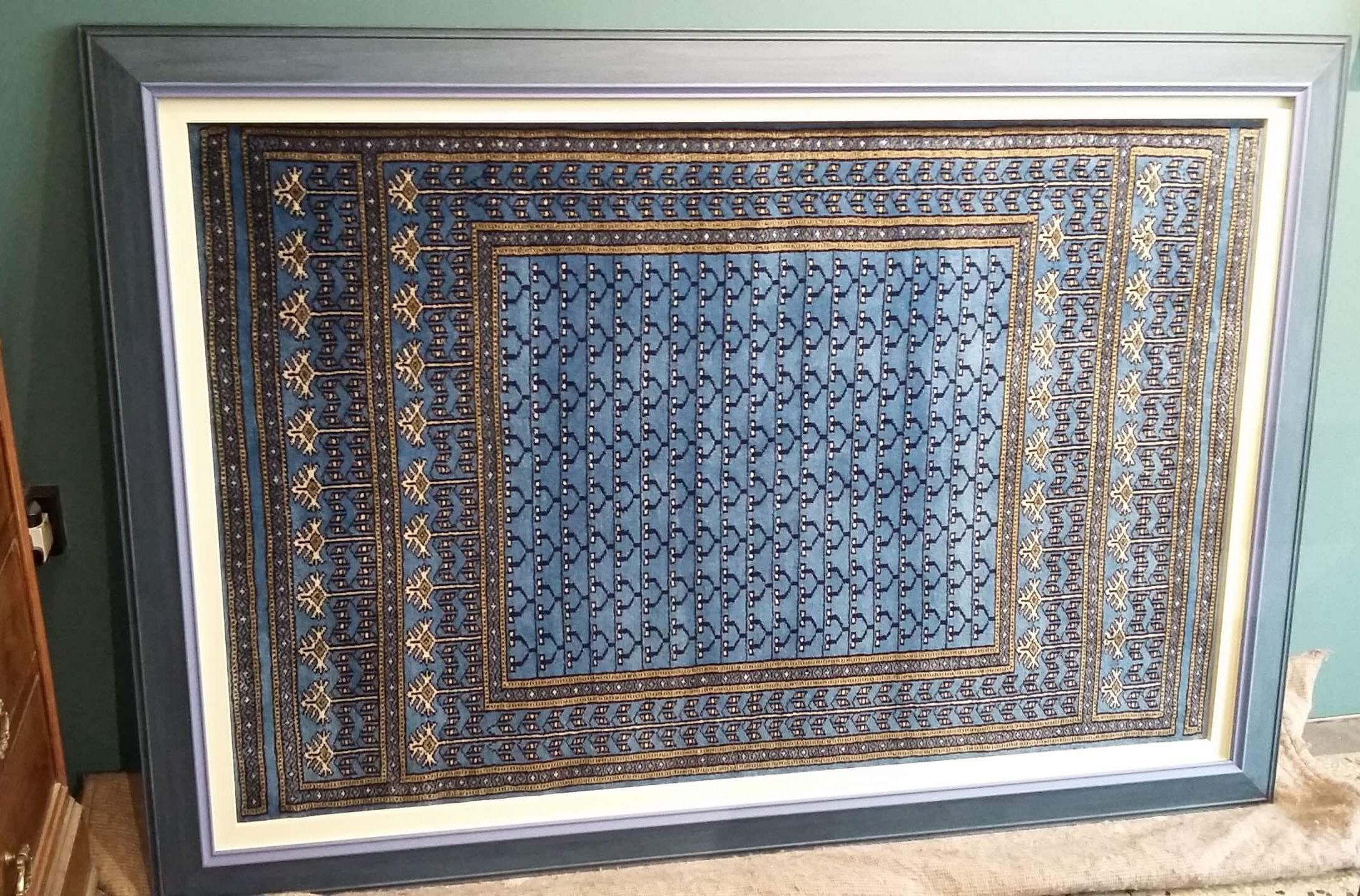 Indian Rug textile framed in a hand painted frame