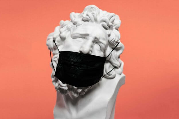 white marble head with face mask